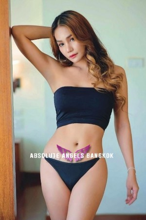 Sexy Bangkok Escort wearing a black bikini in a bedroom ready for sex.