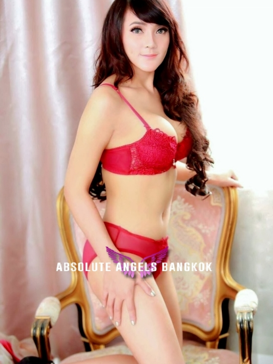 Melissa in red lingerie leaning on gold throne
